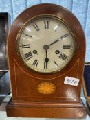 Clocks: 20th cent. Mahogany arched top with inlaid base, silver coloured dial, black Roman numerals,