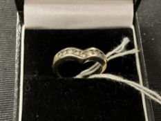 Diamond wishbone ring set with nine brilliant cut stones, estimated weight 0·35ct. stamped and