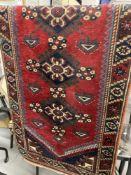 Carpets & Rugs: 19th cent. Kazak style runner with red ground and nine large guls with geometric