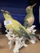 20th cent. Ceramics: Karl Ens bird ornaments Golden Oriel on tree stump. 7½ins. Green Woodpecker