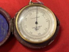 Scientific Instruments: Compensated pocket barometer, gilt cased, dial 2ins. diameter, signed