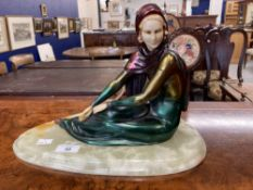 Art deco style figure of a seated lady in the manner of Menneville, cold painted resin on an onyx