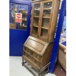 20th cent. Oak bureau bookcase with glazed top and turned stretchers.