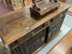 18th/19th cent. French walnut buffet with heavily carved panels depicting folk scenes. 61ins.
