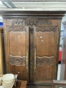 19th cent. French oak armoire with well carved floral & bouquet decoration, fitted ornate brass