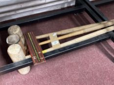 Three polo mallets and wooden snooker scoreboard.
