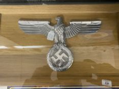 Militaria: Third Reich polished aluminium large eagle and swastika on an oak framed display board.