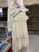 Fashion: Art deco style embossed white satin wedding dress, boat shape neck, long sleeves six button