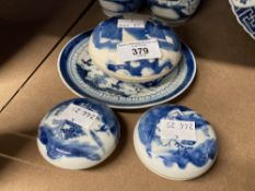 Chinese blue and white shallow circular pots and covers, figures in a garden, dia. 4ins. Plus two