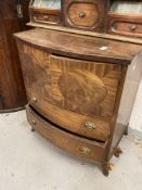 20th cent. Bow front mahogany cupboard with two drawers. 26ins.