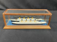 R.M.S. TITANIC: Models of Titanic and Olympic in a glazed case. 10ins.