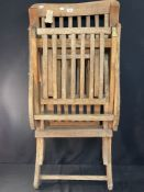 OCEAN LINER: 20th cent. teak steamer chair believed ex. R.M.S. Queen Mary, previous lot no. from