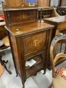 Edwardian rosewood music cabinet with inlaid decoration motif above, glazed. 21½ins. x 52ins high