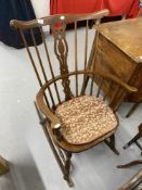 20th cent. Beech Windsor style stick back rocking chair and an early 20th cent. English beech