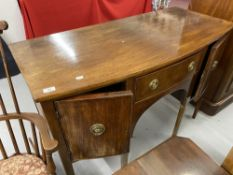 19th cent. Mahogany bow front sideboard, fitted central drawer flanked by a pair of panel doors on