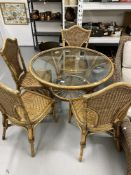 21st cent. Wicker conservatory set. Sofa, armchairs, footstools, dining table and four chairs.