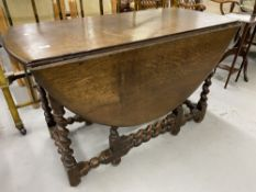 18th/19th cent. Oak gate leg dining table with barley twist supports. 46ins.