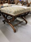 Mid 19th cent. Rosewood cross stretcher upholstered footstool with applied rose motifs.