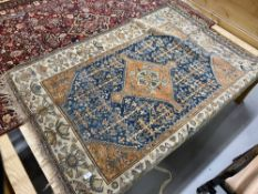 20th cent. Blue ground Persian rug. 66ins. x 50ins.