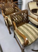 Early 20th cent. Beech armchairs with spring upholstered seats, fretwork backs and turned front