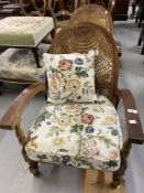 Art deco, a pair of Dutch oak Bergere armchairs on turned supports.