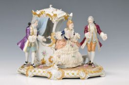 porcelain group, Unterweissbach, 20th c., Beldame with litter and Lackey, painted in bright
