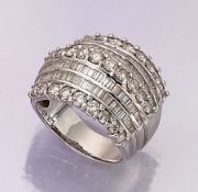 18 kt gold ring with diamonds , WG 750/000, 7-rowed with brilliants and diamond baguettes total