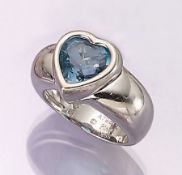18 kt gold PIAGET ring with topaz , WG 750/000, bevelled blue topaz heart (treated), splint heart