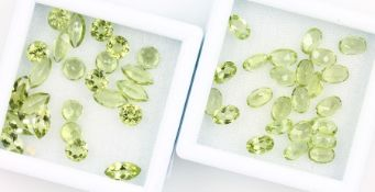 Lot 48 loose peridots , total approx. 24.30 ct, 24 x oval bevelled, 12 x round bevelled, 12 x