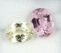 Lot 2 loose kunzites , total approx. 30.87 ct, in different cuts and sizes, 1 x Yellow, 1x Pink,