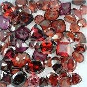 Lot loose garnets , total approx. 68.26 ct, in different cuts and sizes, partially dismounted