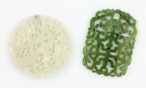 Lot 2 jade discs , total approx. 187.09 ct, with fret work, geschn., polished, 1 x people,1 x