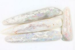 Lot 4 loose opal belemnites , comprised of: 1 x approx. 32.2 ct, approx. 57.6 x 9.9 x 9.6 mm, 1 x