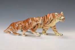 2 figurines, Royal Dux, 20th c., naturalistic polychrome painting, traces of age, L. approx.44/39cm2