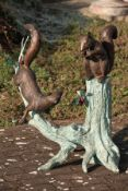 Squirrel on tree trunk, bronze, brown and greenish patinated, cute and naturalistic, slight traces