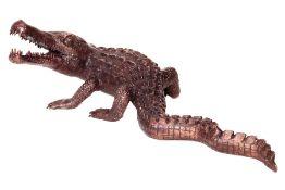 Small crocodile, bronze, dark brown patinated,defensive posture, fine casting, detailed elaboration,