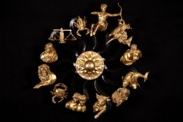 """Wallapplike """"12 zodiac signs"""", bronze, zodiac signs placed on rays around a sun placed in the"""