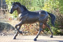 Stallion, bronze, brown and blackish patinated, in trotting representation, naturalistic,
