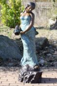 Woman with a jug as a fountain figure, bronze,in various shades of brown and turquoise patinated,