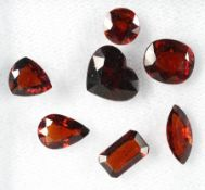 Lot 7 loose bevelled spesartite , total 10.32 ct, in different cuts, red brown Valuation Price: 300,