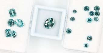 Lot 17 loose bevelled zircones , total 25.32ct, in different shapes and pale- and turquoise shades