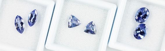 Lot 3 bevelled tanzanite-pairs : 1 x triangle total approx. 1.64 ct; 1 x oval totalapprox. 3.11