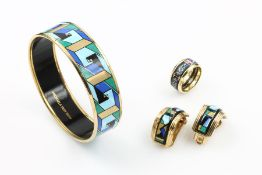 Lot MICHAELA FREY with enamel , metal gilded, comprising of: Pair of earrings with clips and bangle,