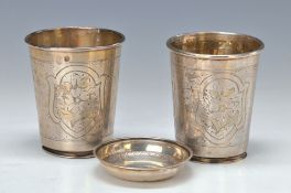 couple of beakers and small bowls, probably Turkey, 19th c., silver driven and enchased, floral