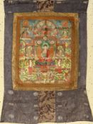 Thangka old, Tibet, around 1930, painting witha silk frame, approx. 91 x 60 cm. Auction: Antique,