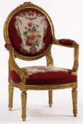 Armchair, frame in solid wood, painted gold, abstract floral decorative frieze and elaborately