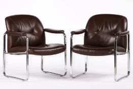 2 armchairs, chromed metal frame, screwed-on seat and armrests with brown leather covers, high-