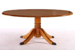 Oval coffee table, solid wood, top probably yew veneer, round column shaft, 4 slightly curved