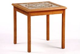 Side table, solid oak, top with 4 recessed tiles, some of which are abstractly floral, slight traces