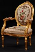 Armchair, frame in solid wood, painted gold, rich ornamental carvings in the form of roses,